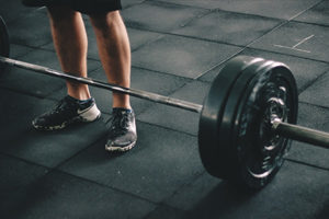 Man improving strength by doing deadlifts