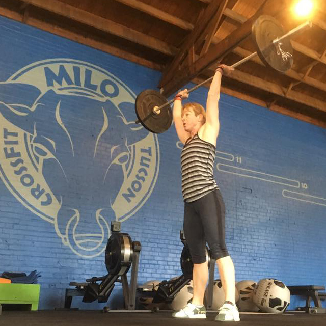 Woman doing olympic weight lifting training