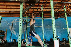 Girl working out in Crossfit Class
