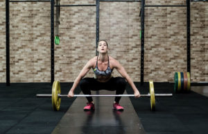 woman setting up olypmic style lift