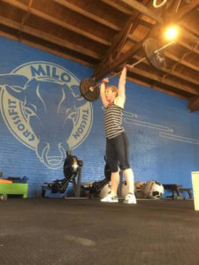 CrossFit Milo Coach Finishing An Olympic Lift